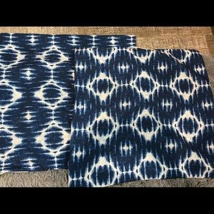Two pillow shams blue/white/tan in back